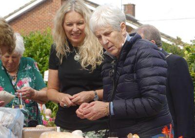 Joyce Rowland (resident), her daughter Pat King and Alice Jupp (volunteer)