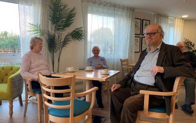 Myra Diemer, Jean Horn and John Munford enjoying coffee morning.